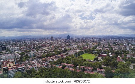 Panoramic aerial view of Mexico City on a day full of clouds. The famous word trade center building is appreciated in the center