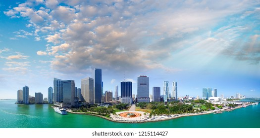 Panoramic aerial view of Miami Downtown at sunset. Buildings and ocean.