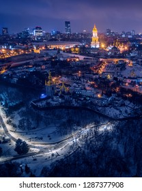 Panoramic aerial view of the night winter Kiev with a clearly marked highway road along the Dnieper River