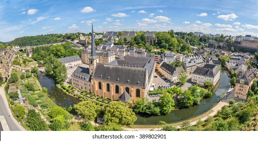 Panoramic aerial view on bend of Alzette river and church of St Jean du Grund in Luxembourg City