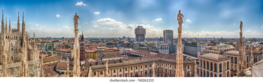 Panoramic aerial view over the city centre, as seen from the roof of the gothic Cathedral, Milan, Italy