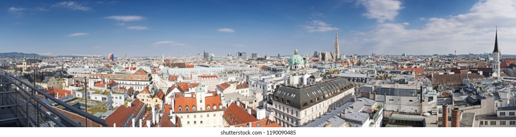Panoramic aerial view over historic old town of Vienna with famous landmarks as St. Stephen's cathedral.
