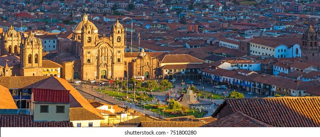 Panoramic aerial view over the main square of Cusco (Plaza de Armas) at sunset with its cathedral and traditional colonial architecture, Peru.