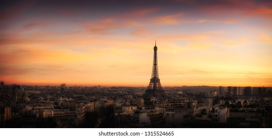 Panoramic aerial view of Paris, France, with the Eiffel Tower and the city skyline at sunset. Dreamy and Vintage scene of Art Deco buildings. Very High Resolution.