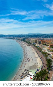Panoramic aerial view of public beach in Nice in a beautiful summer day, France, vertical