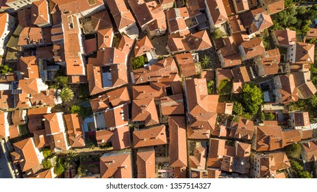 Panoramic aerial view of the red tiled roofs of the old town of Kotor and Kotor Bay