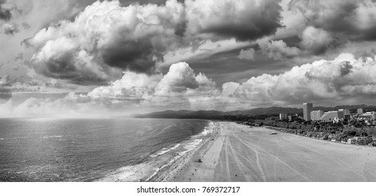 Panoramic aerial view of Santa Monica Beach at sunset in black and white, CA.