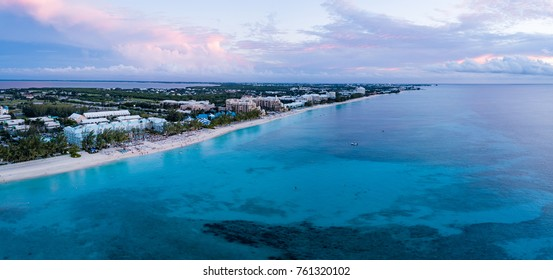 panoramic aerial view of seven mile beach in the tropical paradise of the cayman islands at sunset