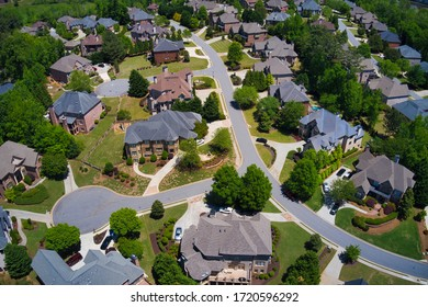 A panoramic aerial view of a subdivision in an upscale area.
