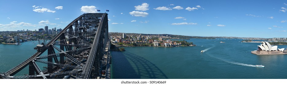 Panoramic Aerial view of Sydney Harbour with Sydney Harbour Bridge and the Opera House from the south-eastern pylon containing the tourist lookout towards North Sydney, New South Wales Australia.