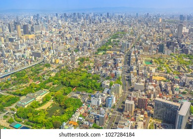 Panoramic aerial view of Tennoji zoo and Osaka cityscape from at viewing platform of a top of Osaka's Abeno Harukas, the tallest skyscraper in Japan. Sunny day.