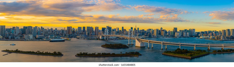 Panoramic Aerial view of Tokyo skylines with Rainbow bridge and tokyo tower over Tokyo bay in daytime from Odaiba in Tokyo city Kanto Japan. panorama photo of city in japan. - Shutterstock ID 1655484805