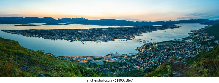 Panoramic aerial view of Tromso and Tromsoysundet strait in Norway during sunset.
