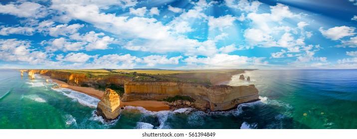 Panoramic aerial view of Twelve Apostles coastline at sunset, Great Ocean Road - Victoria, Australia.