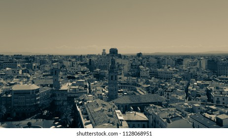 "Panoramic aerial view of Valencia old town, rooftops and skyline from ""El Miguelete"", Cathedral bell tower. Spain. Vintage preset."