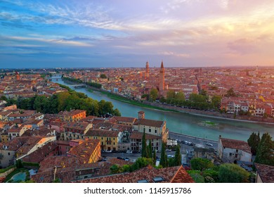 Panoramic aerial view of Verona, Italy at summer sunset, sun lens flare