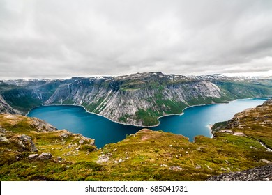 Panoramic aerial wide angle landscape from mountain viewpoint with clouds in cliff during trip Norway.. High resolution panorama, Norway. Trolltunga hiking route.