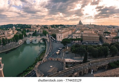 Panoramic aerial wonderful view of Rome with river Tiber and Saint Peter Cathedral at sunset time in Rome, Italy