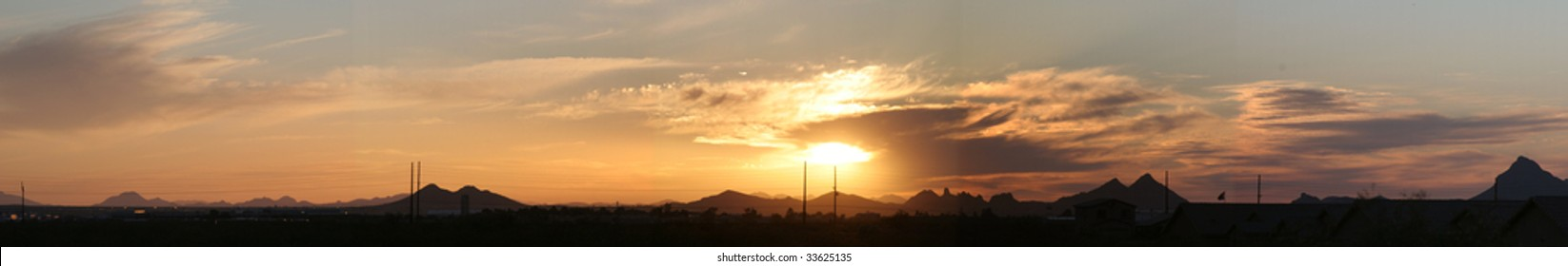 Panoramic of an Arizona sunset with power lines visible in the distance