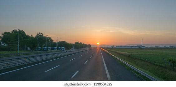Panoramic background of motorway at sunrise