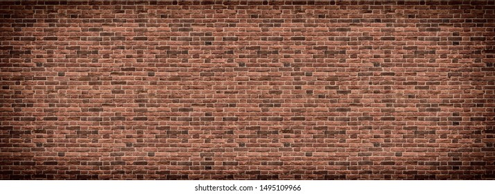 Panoramic background of wide old red and brown brick wall texture. Home or office design backdrop. Vintage brickwall