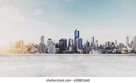 Panoramic Bangkok city in sunrise modern buildings, and concrete deck floor. City Background