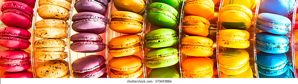 Panoramic banner background with traditional french dessert colorful macarons