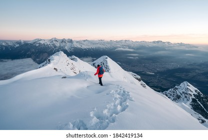 Panoramic banner of man trekking in snow covered mountain. Sport  concept. Silhouette trail hiker in mountain summit background. Hiker on the or alpiniston run training outdoors active fit lifestyle.