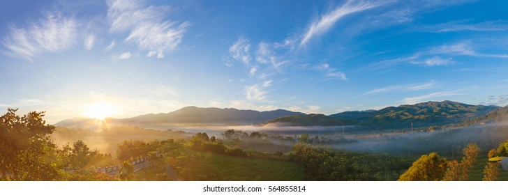 Panoramic beautiful Misty Morning with Beautiful Sunrise which clear blue sky in morning at Doi Mae Salong, Chiang Rai, Thailand.