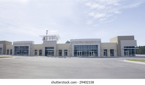 panoramic beige, brown and white strip mall with stone accents