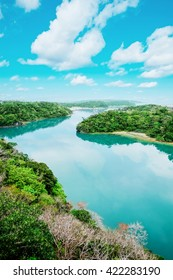 Panoramic bird eye aerial view of beautiful river mirror with fantasy blue sky in Okinawa, Japan