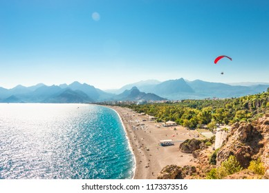 Panoramic bird view of Antalya and Mediterranean seacoast and beach with a paraglider, Antalya, Turkey, Autumn