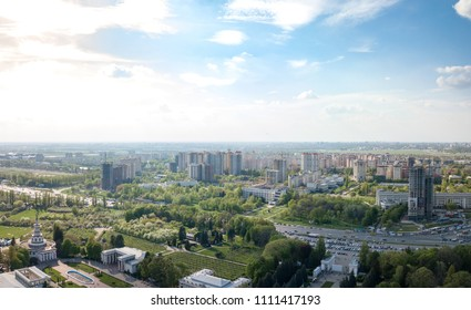 The panoramic bird's eye view shooting from drone to modern city district with urban infrastructure and residential buildings of Kiev, Ukraine at summer sunset.