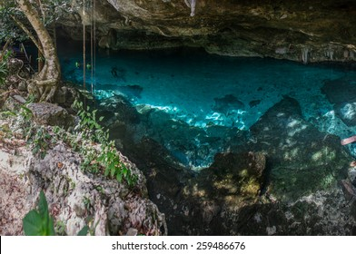 Panoramic, Blue fresh water at cavern near Tulum. Cenote dos Ojos.