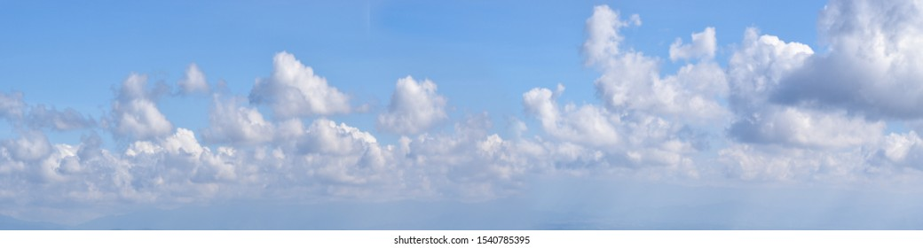 panoramic blue sky background with white clouds