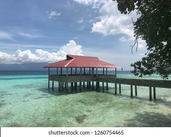 Panoramic blue watercolor beach with a long bridge and floating house in Ambon Indonesia