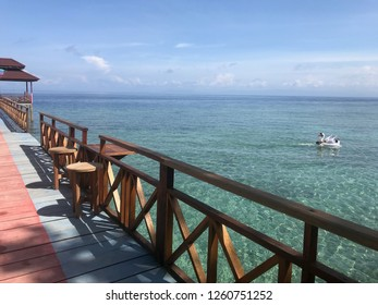 Panoramic blue watercolor beach with wooden bridge in Ambon Indonesia