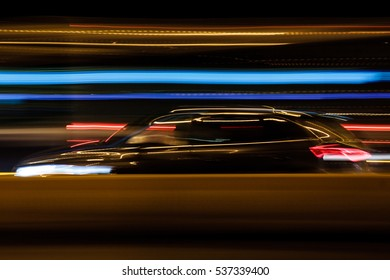 Panoramic blur of a car in traffic from side