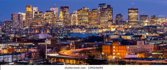 Panoramic of Boston Cityscape with highway trail to Boston MA USA at night.
