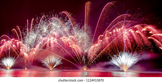 Panoramic Brightly Colorful Fireworks shot over the sea
