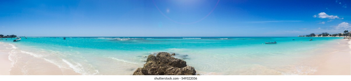 Panoramic Caribbean beach with white sand and turquoise sea