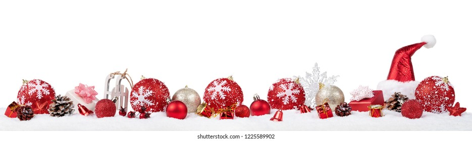 Panoramic christmas ornaments in the snow isolated on white background