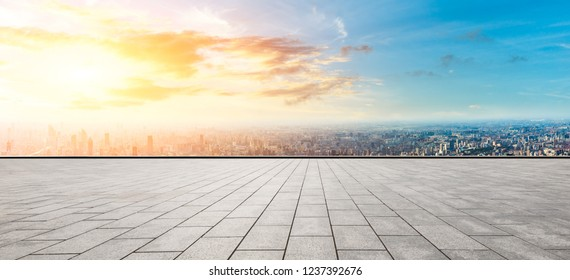 Panoramic city skyline and buildings with empty square floor