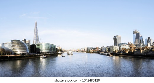 Panoramic city skyline of London across Thames River