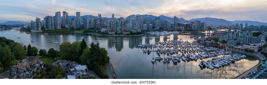 Panoramic City Skyline View of Downtown Vancouver around False Creek area from an Aerial Perspective. Taken in British Columbia, Canada, during a colorful sunrise.