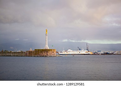 Panoramic. City view. The central port (harbour) of Messina with golden statue of st. Madonna and ships on a cloudy day with the view on Reggio Calabria. Messina. Sicily. Italy