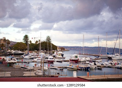 Panoramic. City view. The central port (harbour) of the city of Messina with yachts and small boats on a cloudy day with the view on Reggio Calabria. Messina. Sicily. Italy