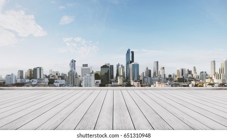 Panoramic city view with empty white wooden floor