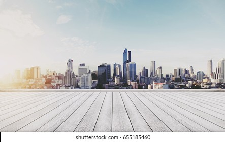 Panoramic city view in sunrise with wooden floor