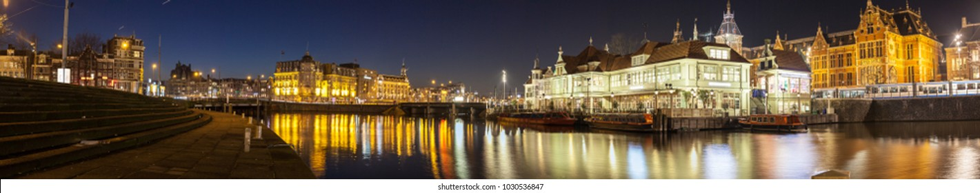 Panoramic Cityscape of Amsterdam at winter night. Shot on tripod with long exposure.